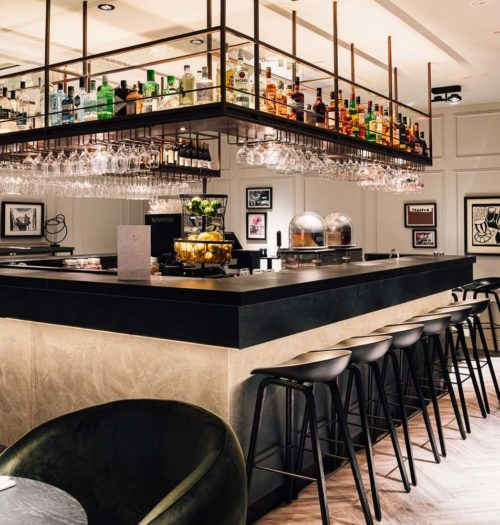 The bar with black stools in Hotel Brussels Centre